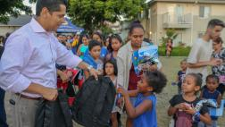 Asm. Santiago gifting backpacks