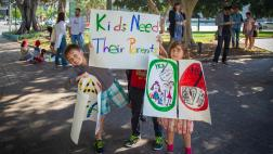Kids holding signs