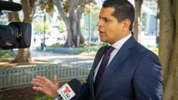 Asm. Santiago speaks with reporter